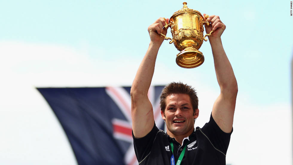 All Blacks captain Richie McCaw shows off the William Webb Ellis Trophy to the massive crowd in Auckland