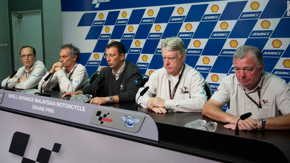 Race officials at a press conference to announce the death of Italian rider Simoncelli.