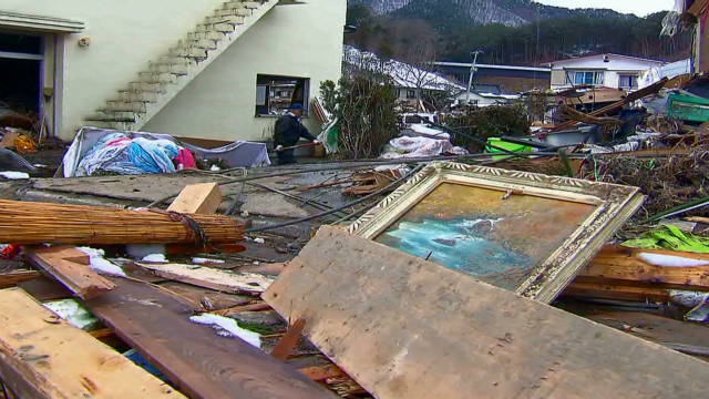 Quake, tsunami debris threaten coastlines