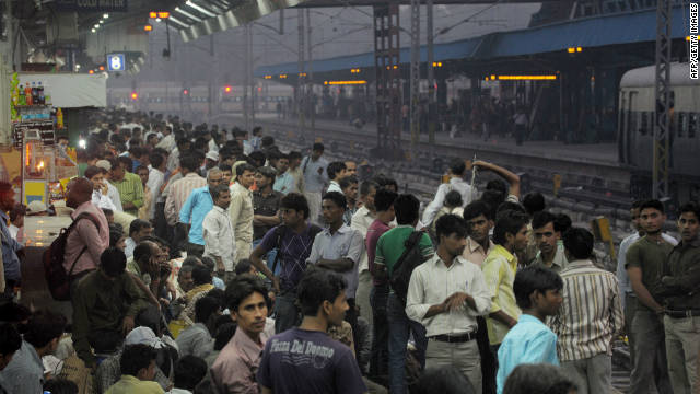 Commuters crowd a platform at a train station in downtown New Delhi, one of the world's most populous cities, on October 25.