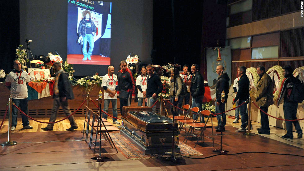 People queue to see Simoncelli's coffin and pay their final respects to their late hero.