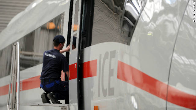 An employee of German industrial giant Siemens works on an ICE 3 high speed train.