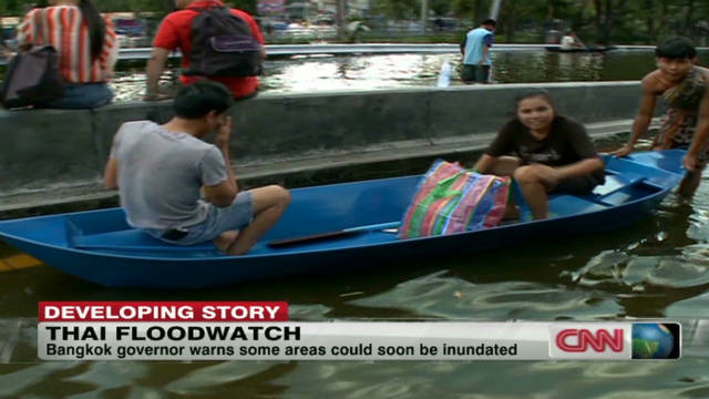Bangkok residents battle floodwaters