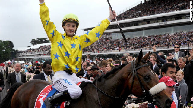 Christophe Lemaire celebrates after winning the $6.4 million Melbourne Cup with Dunaden.