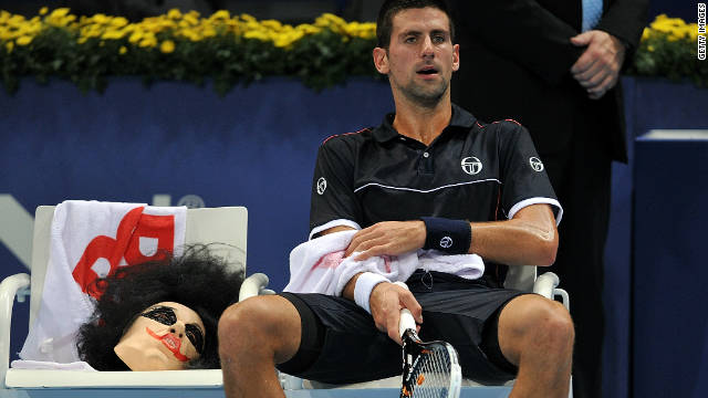 Novak Djokovic sits next to his Halloween mask during his match against Xavier Malisse at St Jakobshalle.