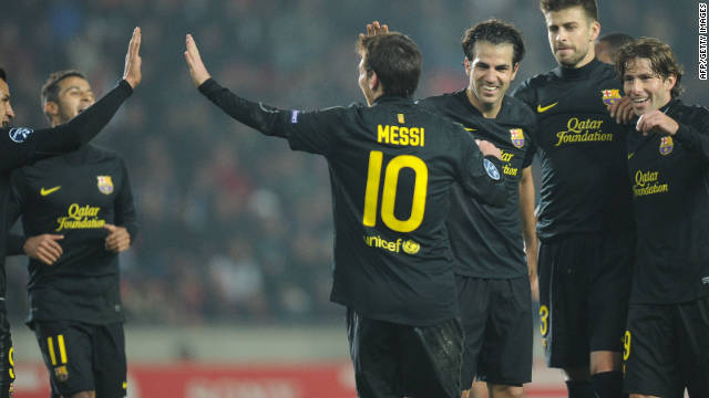 Barcelona's Lionel Messi celebrates with his teammates after scoring his third goal in Prague on Tuesday.