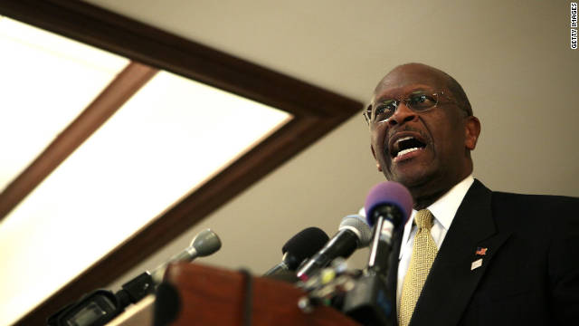 Herman Cain addresses an event Wednesday in Virginia. He didn't answer reporters' questions about harassment allegations.
