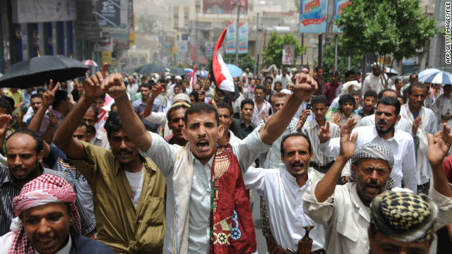 The file photo shows Yemeni anti-government protesters in the southern city of Taiz on July 22, 2011.