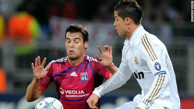 Lyon midfielder Yohan Gourcuff, left, vies with Real Madrid's Cristiano Ronaldo at Gerland stadium.