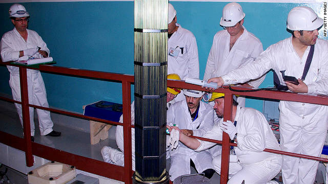 Workers carry out inspections at a nuclear power plant in Bushehr, in southern Iran, on August 21, 2010.