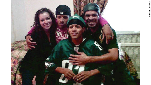 Edwin Sanabria, front, was recently reunited with his family including his brother Robert, second from left.
