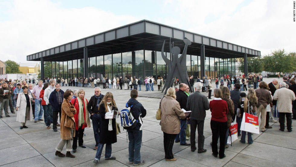 "Visitors queue outside the Neue Nationalgalerie in Berlin, Germany. Adjaye cites the structure as a ""masterpiece"" and ""a temple of modernity."""