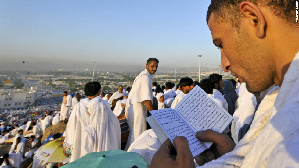 Pilgrims read from the Quran atop Mount Arafat on Saturday in Mecca.