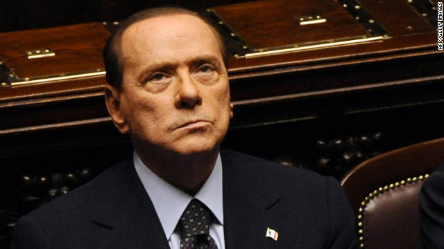 Italy's Prime Minister Silvio Berlusconi reacts prior a vote on Italy's public accounts at the parliament on November 8, 2011 in Rome. Prime Minister Silvio Berlusconi's main coalition partner, Umberto Bossi, called for his resignation the same day ahead of a knife-edge vote as Italy came under acute pressure from record borrowing rates to finance debt. AFP PHOTO / VINCENZO PINTO (Photo credit should read VINCENZO PINTO/AFP/Getty Images)