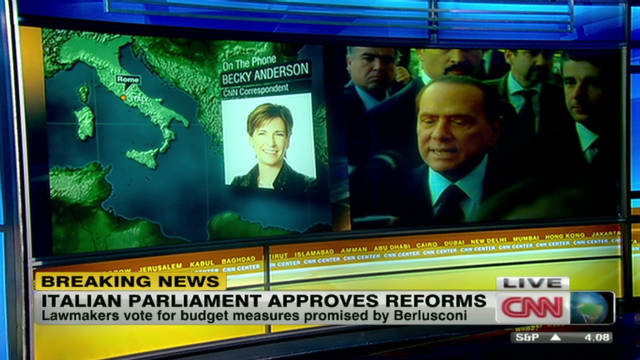 Berlusconi wins crucial budget vote