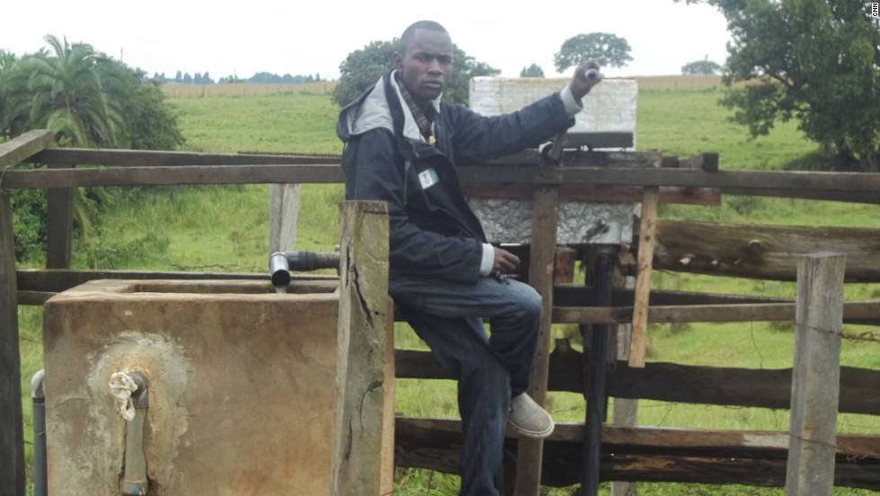 Kenyan entrepreneur Joe Mwali poses beside the borehole he created to provide water for his local community.