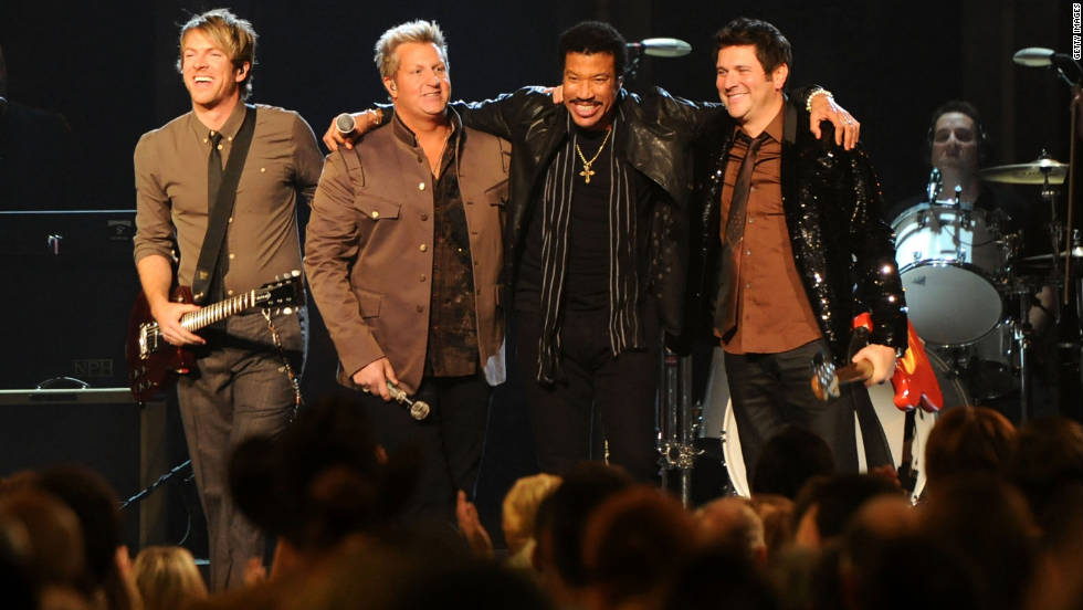 "Lionel Richie hugs members of Rascal Flatts after their performance together in celebration of his upcoming country album, ""Tuskegee."""