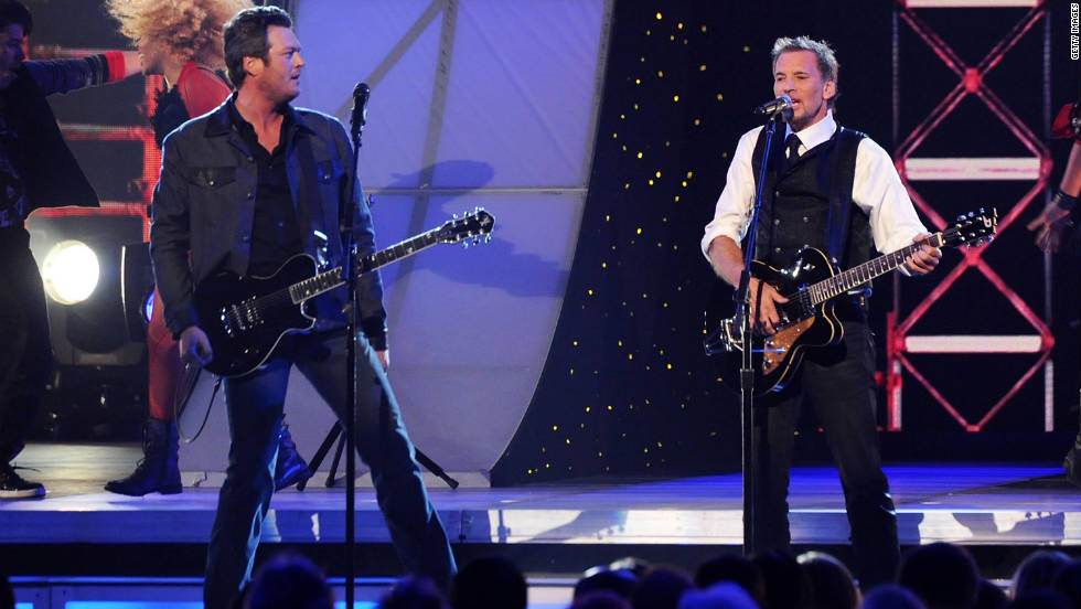 "Blake Shelton and Kenny Loggins open the show by singing ""Footloose."" Loggins co-wrote and sang the original for the 1984 film, while Shelton did a cover version this year. Shelton picked up the CMA Award for best male vocalist for the second year in a row."