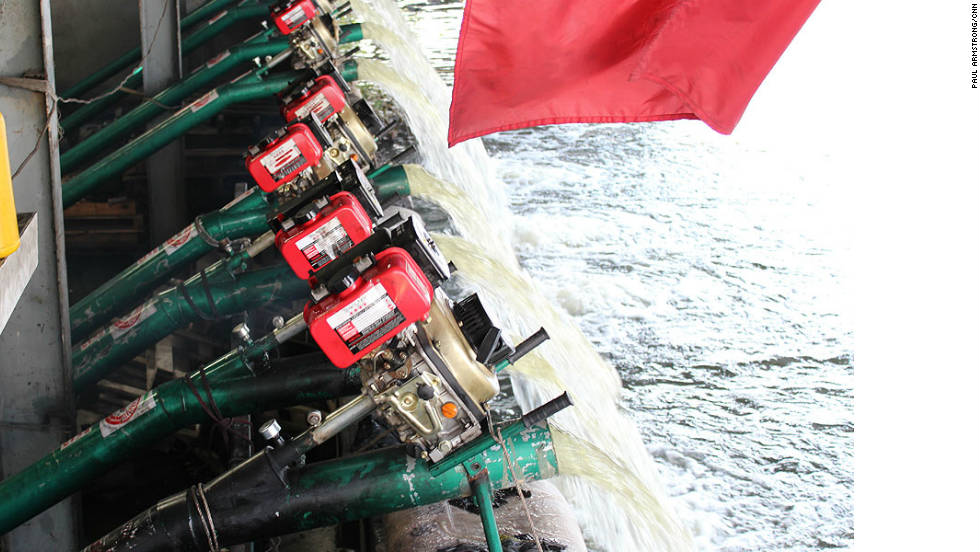 Romeo has dozens of pumps set up to flush out the water, a sight and sound typical of Bangkok right now.