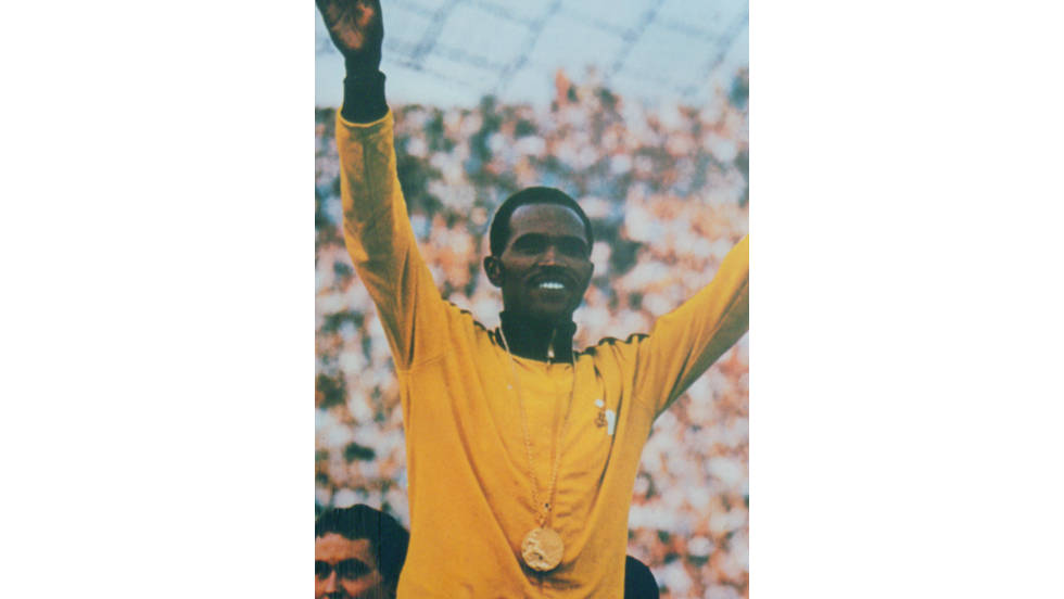 In a glittering career, the Kenyan athlete won gold medals in both the 1968 and 1972 Olympic Games as well as three golds at the Commonwealth Games .