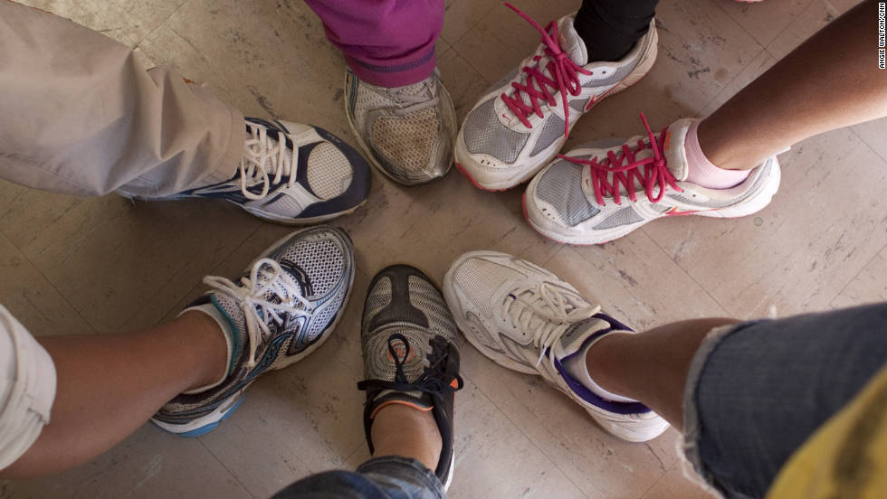 The students show off their sneakers, donated by volunteer Bobby King. The school survives solely on grants and donations.