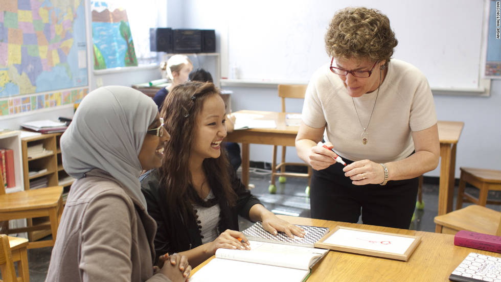 Kelley Provence, right, is the school's academic director and reading teacher. The Global Village school occupies the education wing of a local church that donates space.