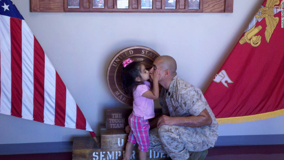 "Ashley Gomez <a href=""http://ireport.cnn.com/docs/DOC-701104"">posted a tribute to her husband</a>, Gunnery Sergeant Elder Gomez. The two have been married for five years and have a three-year-old daughter, Evie. Gomez has served in three combat tours to Iraq, is a black belt instructor in the Marine Corps Martial Arts program, has mentored at-risk teens in their local school system and is a sheriff's deputy. ""I admire him for his selflessness,"" Gomez said. ""My sister once said, 'I am so happy that Elder willingly goes so that my sons don't have to go.' I used to cry at the thought of deployments, and I still do, but I think about my sister's comment, and it brings me peace."""