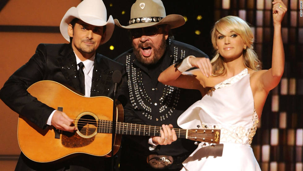 Hosts Brad Paisley and Carrie Underwood kick off the 45th annual Country Music Association Awards with Hank Williams Jr. at the Bridgestone Arena in Nashville on Wednesday, November 9.