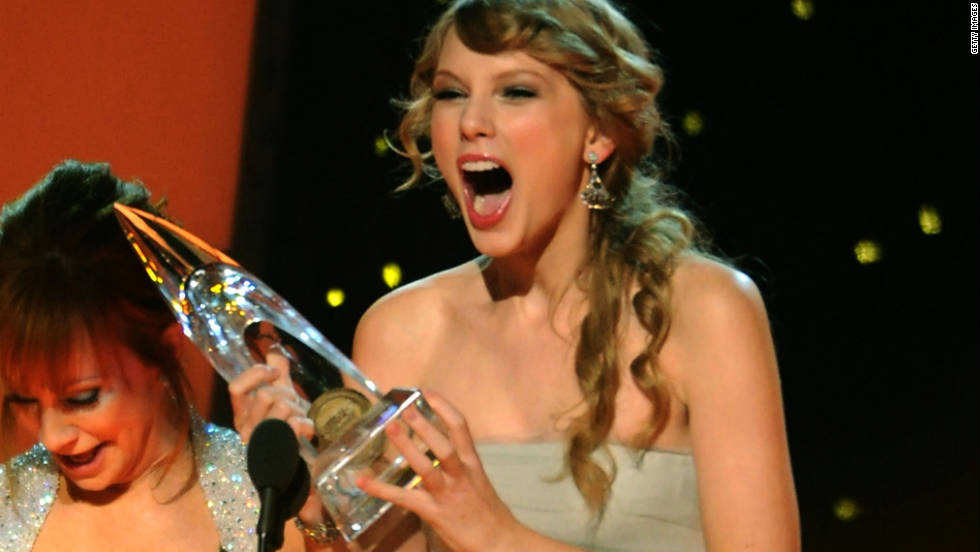 "Taylor Swift accepts the award for the 2011 entertainer of the year. ""Winning that the first time was like the best thing that ever happened to me, and then to win it again it's absolutely insane. I'm so excited!"" Swift said."