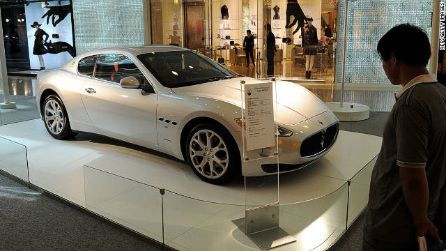 A man looks at a Maserati sports car on display at a luxury mall in Shanghai in September, 2011.