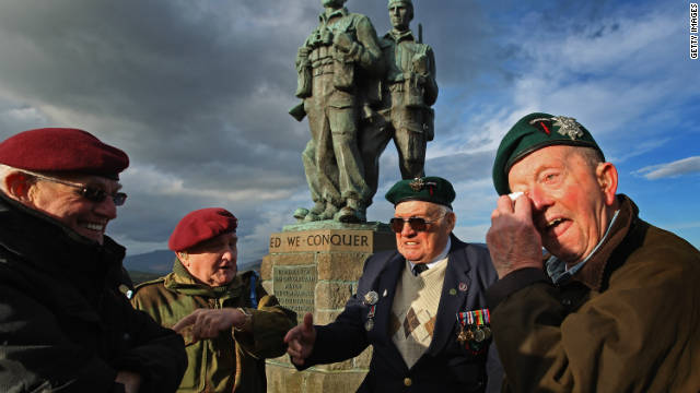 Veterans observe the two-minute silence at Spean Bridge in Scotland as a mark of respect for the war dead on November 11, 2011.