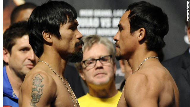 Boxers Manny Pacquiao, left, and Juan Manuel Marquez pose during the official weigh-in for their bout Friday in Las Vegas.