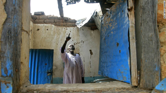 A Sudanese man surveys damages last month at his house caused by fighting in the border region of South Kordofan.