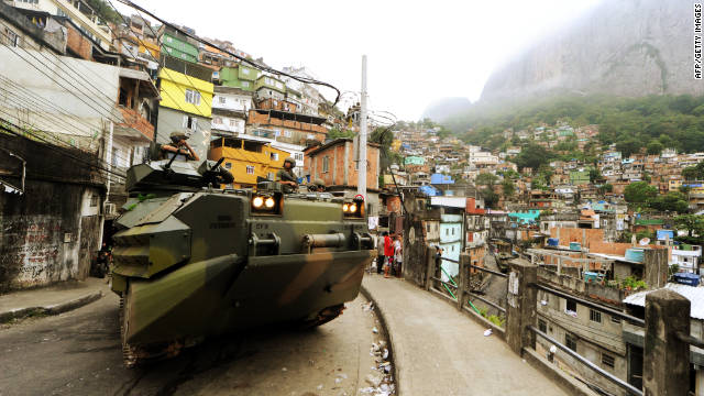Marines drive an amphibious assault vehicle through the Rocinha shantytown on Sunday.