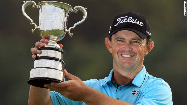 Greg Chalmers holds the Australian Open trophy aloft, 13 years after his last victory.