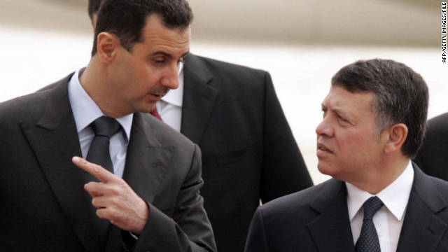 Jordan's King Abdullah, right, welcomes Syrian President Bashar al-Assad upon his arrival for a visit to Amman in 2009.