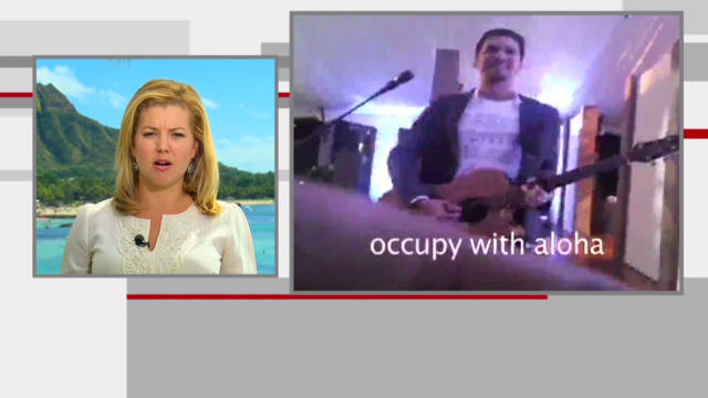 Occupy protester performs at APEC gala