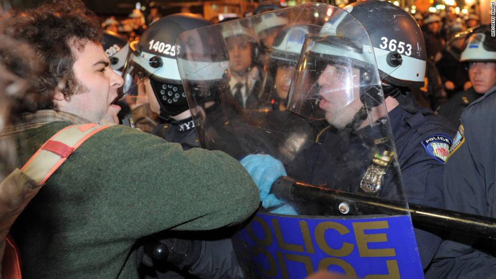 A man is confronted by police as New York City officials clear the 'Occupy Wall Street' protest from Zuccotti Park last November.