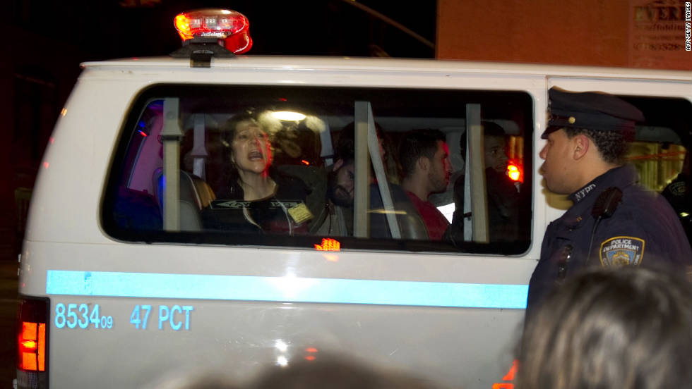 An arrested protester screams from a police van Tuesday.