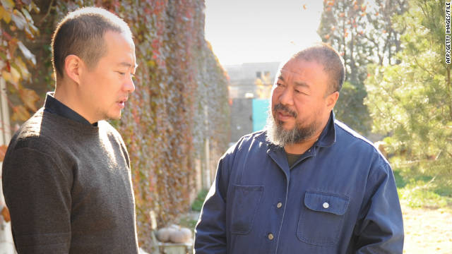 Chinese artist Ai Weiwei (R) talks to an unidentified friend in the his courtyard home and studio on November 9.