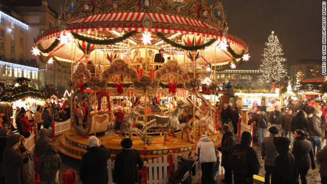 Visitors watch an ornate merry-go-round at the illuminated Dresdner Striezelmarkt Christmas market on November 26, 2010 in Dresden, Germany. The Striezelmarkt claims to be Germany's oldest Christmas market and dates back to 1434. Christmas markets have a long tradition in Germany and usually sell gluhwein, Christmas decorations and ornaments, sweets and sausages.