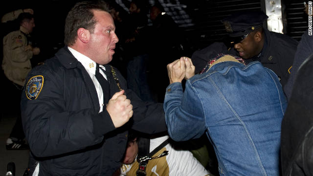 A New York police officer scuffles with Occupy Wall Street protesters in November 2011.