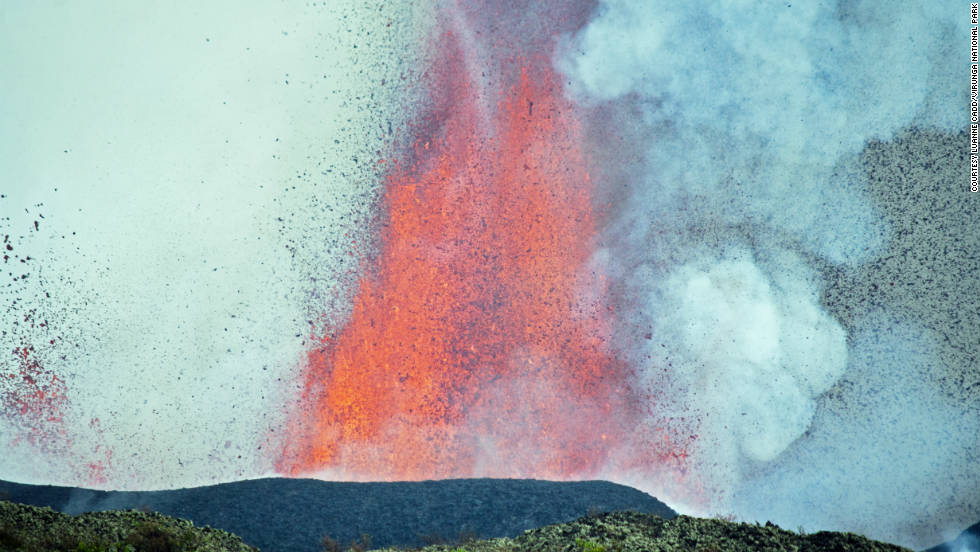 A close up shot of Mount Nyamulagira seemingly spewing small, weightless lava pebbles.