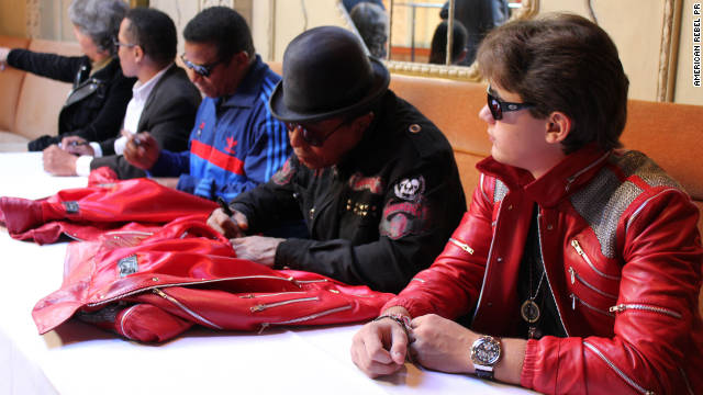 "Prince Jackson with uncles Jackie, Marlon, and Tito Jackson,  seen here signing special edition ""Beat It"" jackets last month."