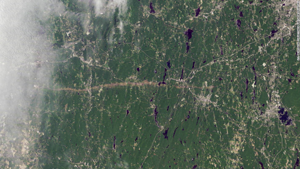 "The thin horizontal strip of brown snaking across this NASA satellite image is the trail of destruction caused by a <a href=""http://earthobservatory.nasa.gov/IOTD/view.php?id=50854"" target=""_blank"">tornado on June 1</a> as it tore across southwest and south-central Massachusetts.  It continued for 39 miles (63 kilometers), says NASA, and in some places measured half-a-mile in diameter. The WMO reports that it was one of the most active tornado seasons on record. 157 people lost their lives -- the deadliest in the U.S. since 1947 -- in <a href=""http://edition.cnn.com/2011/OPINION/05/29/hunter.tornado.joplin/index.html"">Joplin, Missouri</a> in May."