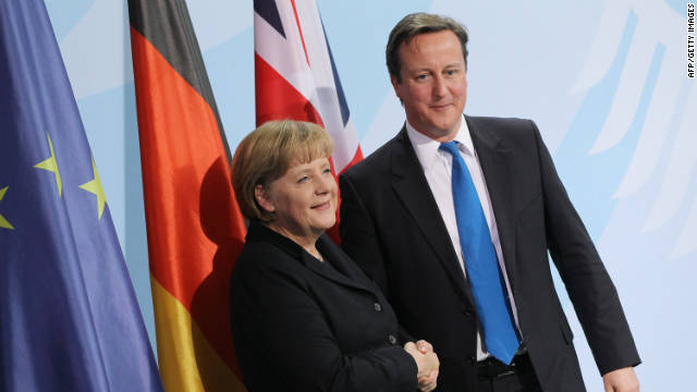 Angela Merkel and David Cameron shake hands after a press conference in Berlin on November 18, 2011.