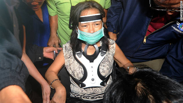 Former Philippine president Gloria Arroyo arrives at the Manila International Airport on November 15, 2011. She was blocked from leaving the country.