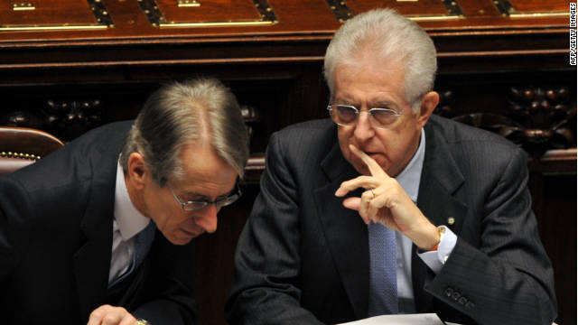 Italian prime minister Mario Monti speaks with his foreign minister before a vote of confidence in Italy's lower house of Parliament.