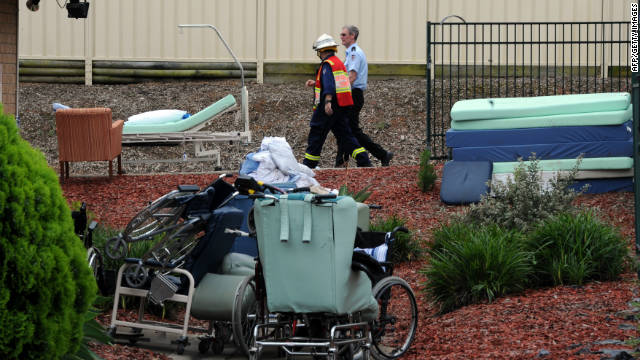 Firemen pass abandoned wheel chairs and hospital beds after a fire engulfed a nursing homes for the elderly, killing at least three and seriously injuring eight, near Sydney on November 18.