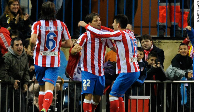 Diego (center) celebrates his goal as Atletico Madrid inflicted a third successive defeat on Levante.